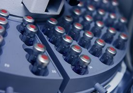 picture of hplc  - Capped vials on an analysis autosampler selective focus - JPG