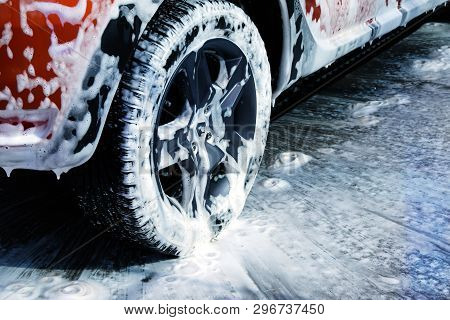 poster of Car Wheel Close Up. Car Is Cleaning With Soap Suds At Self Service Car Wash. White Lather On Auto.