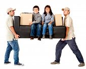 Delivery men carrying a heavy couch with kids - isolated over a white background