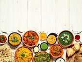 Indian Cuisine Dishes: Tikka Masala, Dal, Paneer, Samosa, Chapati, Chutney, Spices. Indian Food On W poster
