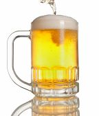 beer pouring on mug