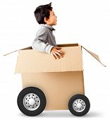 Boy in a car made of cardboard box - express delivery concepts