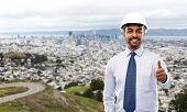 architecture, construction business and building - smiling indian architect or businessman in helmet poster