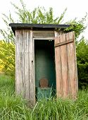 pic of outhouse  - An old deserted outhouse in the country - JPG