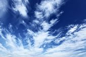 Blue sky with fleecy clouds, may be used as background