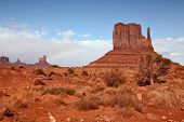 World-wide well-known Mittens from red sandstone. Red Desert. Monument Valley - Navajo Reservation during the summer thunderstorms. poster