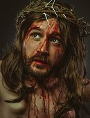 representation of the Calvary of Jesus Christ on the cross. Holy Week in Spain. man with crown of th poster