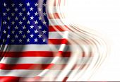 stock photo of waving american flag  - American flag waving in the wind with some folds - JPG