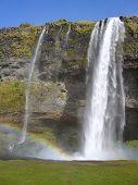 Skogafoss waterfall with rainbow, Iceland. poster