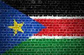 stock photo of sudan  - An image of the South Sudan flag painted on a brick wall in an urban location - JPG