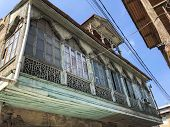 Old Carved Beautiful Antique Balcony Of A Wooden European House. European Old Architecture. poster