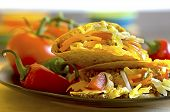 picture of shredded cheese  - Tacos on plate with vine ripe tomatoes red and green chili peppers - JPG