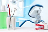 Dental Health And Teethcare Concept. Dental Mirror With Explorer Probe And Toothbrush In White Tooth poster