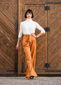 Girl With Makeup Posing In Fashionable Clothes. Fashionable Outfit Slim Tall Lady. Woman Confidently poster