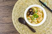 Shrimp Wonton With Carrot Heart Shape In Soup On Wooden Table - Asian Food Style  / Select Focus Ima poster