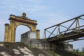 Vietnam Dmz - Triumphal Arch On North Vietnamese Side Of Bridge Crossing River.