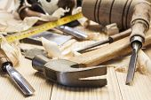 picture of joinery  - several carpenter tools over pine wood table