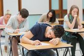 Man sleeping during exam in exam hall