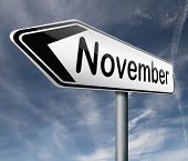 november pointing to next month of the year autumn road sign arrow