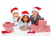 Happy kids in Santa's hat with gift box