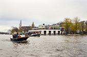 Amsterdam, The Netherlands - November, 18, 2012 - Trumpeter Playing On A Boat Carrying People Greet