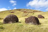 Moai Hats On Hillside In Easter Island