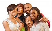 Happy African American family with teenage kids smiling on white background. Shallow DOF, focus on c