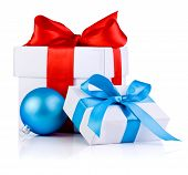 Two White Boxs Tied With A Satin Ribbon Bow And Blue Christmas Balls Isolated On White Background
