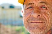 Old Wrinkled Man With Yellow Cap