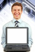 Young Businessman Presenting A Laptop