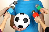 Conference meeting microphones and footballer