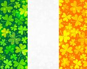 stock photo of triskele  - Vector Irish flag background made from green and orange clovers - JPG