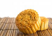 Traditional brown mooncakes. Chinese mid autumn festival foods. The Chinese words on the mooncakes means assorted fruits nuts, not a logo or trademark.