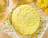 Traditional Chinese mid autumn festival food. Snowy skin mooncakes.  The Chinese words on the mooncakes means lotus paste, not a logo or trademark.