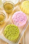 Snowy skin mooncakes.  Traditional Chinese mid autumn festival food. The Chinese words on the mooncakes is green tea with red bean paste, noble delight and lotus paste, not a logo or trademark.