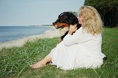 Dog And Woman Sitting