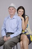 Portrait of an old man eighty years old with twenty years ' granddaughter