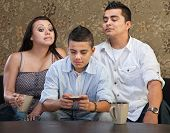 Parents Watching Teen Sending Messages