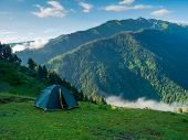 stock photo of tent  - Tent in the hikers camp in mountains - JPG