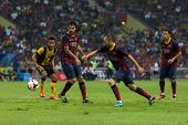 KUALA LUMPUR - AUGUST 10: FC Barcelona's Andres Iniesta (blue boots) dribbles the ball in a friendly match vs Malaysia at the Shah Alam Stadium on August 10, 2013 in Malaysia. Barcelona wins 3-1.