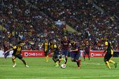 KUALA LUMPUR - AUGUST 10: Barcelona's Jordi Alba (red boots) leads the attack against Malaysia in match played at the Shah Alam Stadium on Aug 10, 2013 in Malaysia. FC Barcelona wins 3-1.