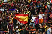 KUALA LUMPUR - AUGUST 10: Malaysian and FC Barcelona fans fill up the stadium for a friendly match at the Shah Alam Stadium on August 10, 2013 in Malaysia. FC Barcelona is on an Asia Tour to Malaysia.