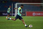 KUALA LUMPUR - AUGUST 9: FC Barcelona Dani Alves kicks the ball during training at the Bukit Jalil Stadium on August 09, 2013 in Malaysia. FC Barcelona is on an Asia Tour to Malaysia and Thailand.