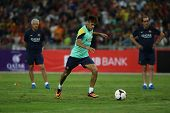 KUALA LUMPUR - AUGUST 9: FC Barcelona's Neymar kicks the ball during training at the Bukit Jalil Sta