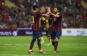 KUALA LUMPUR - AUGUST 10: Barcelona's Neymar (left) and Cesc Fabregas celebrate a goal scored against Malaysia at the Shah Alam Stadium on Aug 10, 2013 in Malaysia. FC Barcelona wins 3-1.