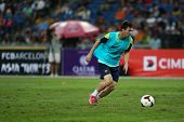 KUALA LUMPUR - AUGUST 9: FC Barcelona's Argentinian striker Lionel Messi prepares to shoot during training at Bukit Jalil National Stadium on August 9, 2013 in Malaysia.