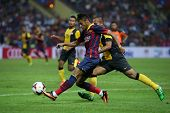 KUALA LUMPUR - AUGUST 10: FC Barcelona's Neymar Jr. (maroon/blue) shoots at goal in a match against