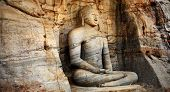 Unique monolith Buddha statue in Polonnaruwa temple - medieval capital of Ceylon,,UNESCO World Herit