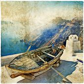 old wooden boat on Santorini, retro picture