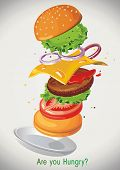 Flying classic hamburger on green background. Big hamburger with fresh ingredients. Fast food product